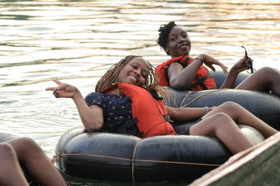 Tubing the Nile Flat water Tubing . Youths in Uganda enjoy Flat water Tubing on the Nile